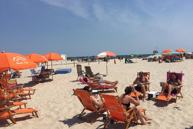 Sunbathers at Sunny Atlantic Beach Club in Atlantic Beach, N.Y. PHOTO: MICHAEL KAPLAN